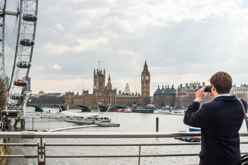 Man photographing London skyline royalty free stock image