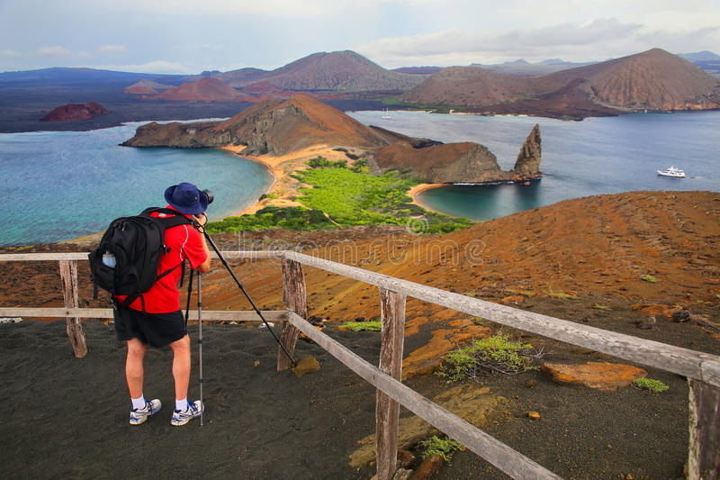 Man photographing panoramic view of Bartolome island in Galapagos stock image