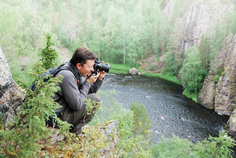 Download Man Photographing On The Top Of Taiga Forest. Stock Image - Image: 20058437