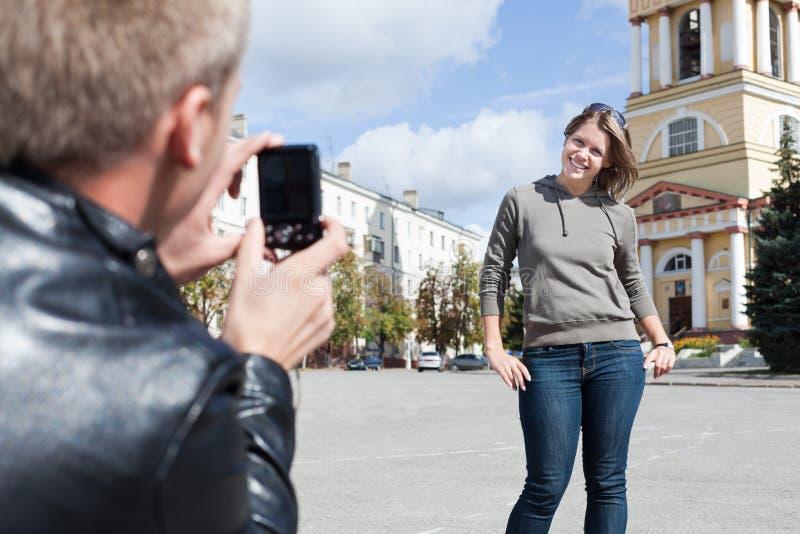 Man photographing young girl stock photos