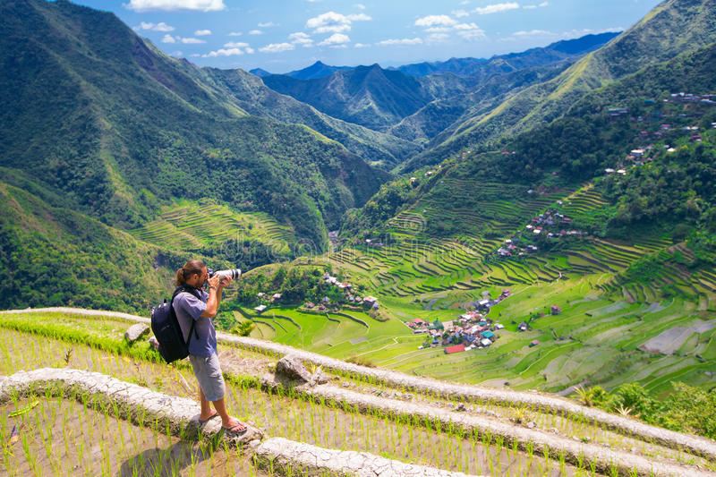 A man photographs the landscape. Rice terraces in the Philippine royalty free stock photography