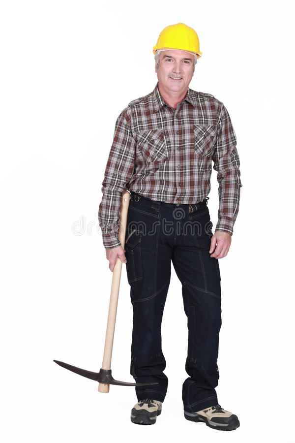 Man with pick-axe royalty free stock image