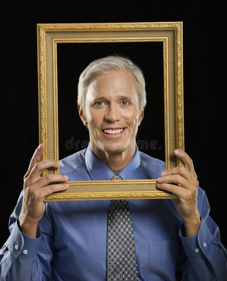 Download Man in picture frame. stock photo. Image of half, holding - 4245978
