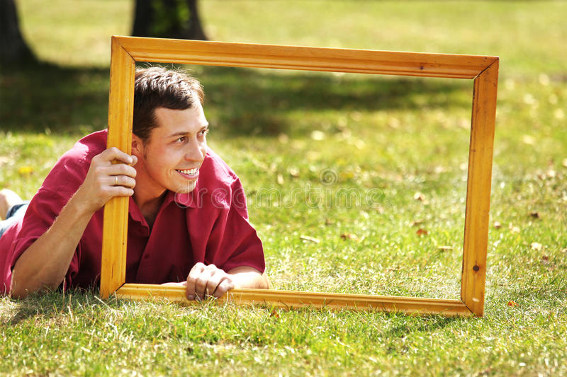 Man in the picture frames. The man in the picture frames royalty free stock images
