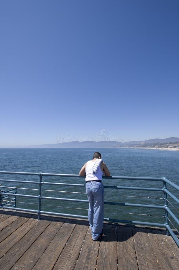 Man on pier stock photo