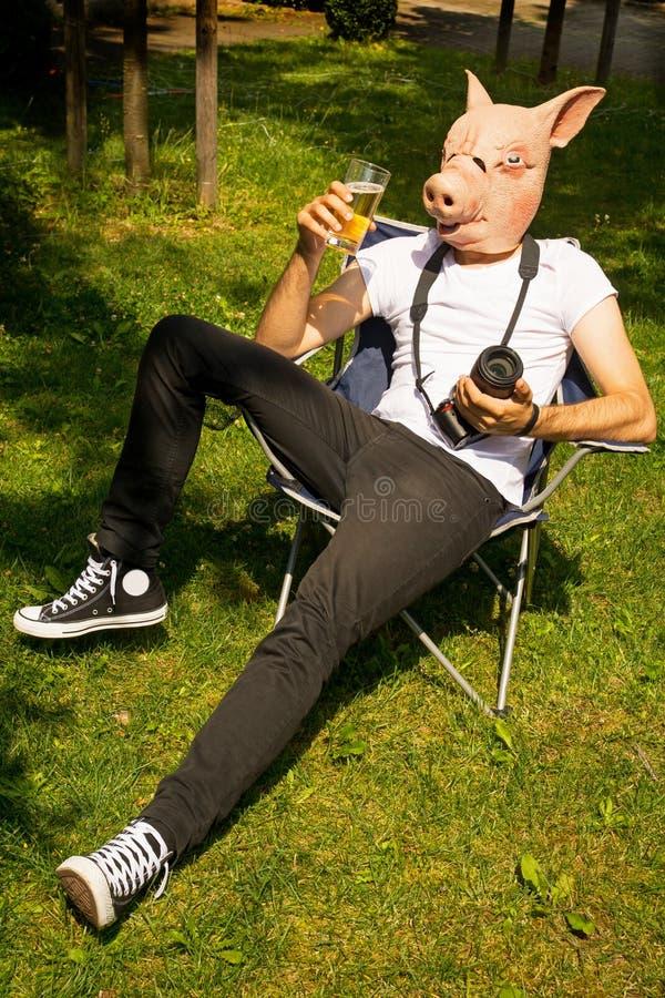 Man pig photographer celebrating royalty free stock image