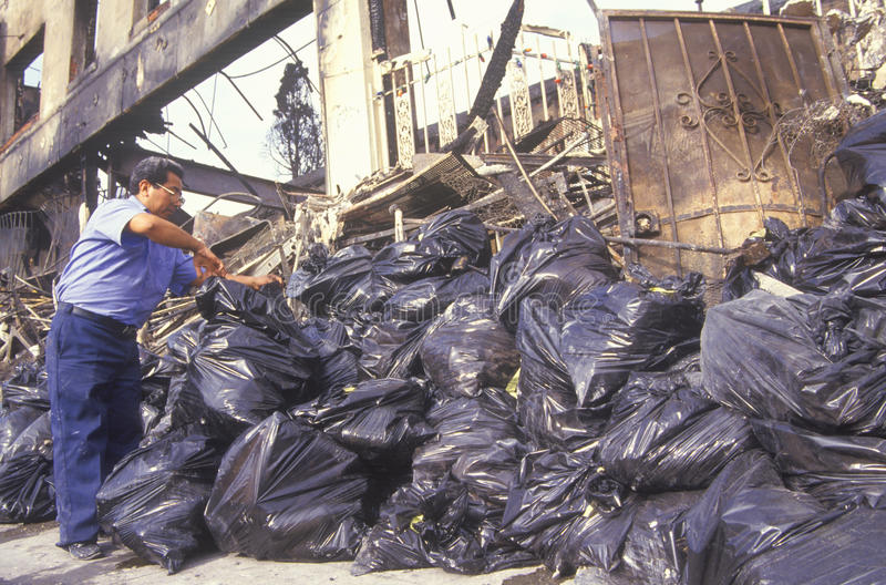 Man piling trash bags