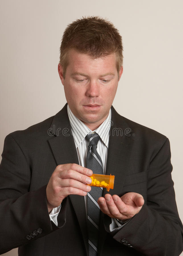 Man With Pills Drugs Royalty Free Stock Images