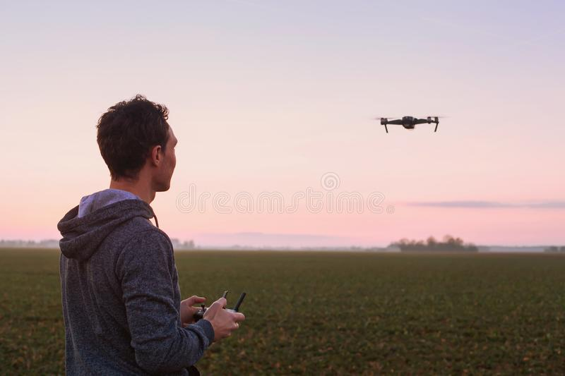 Man piloting drone stock image