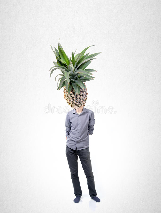 Man and pineapple with concept on a background. stock photos