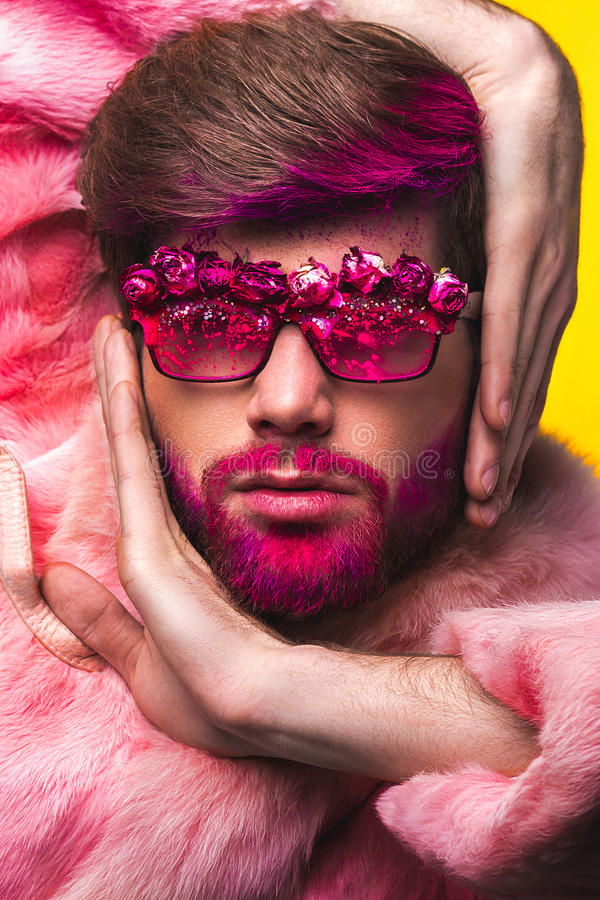 Man in a Pink Fur Coat and Carnival Glasses royalty free stock image