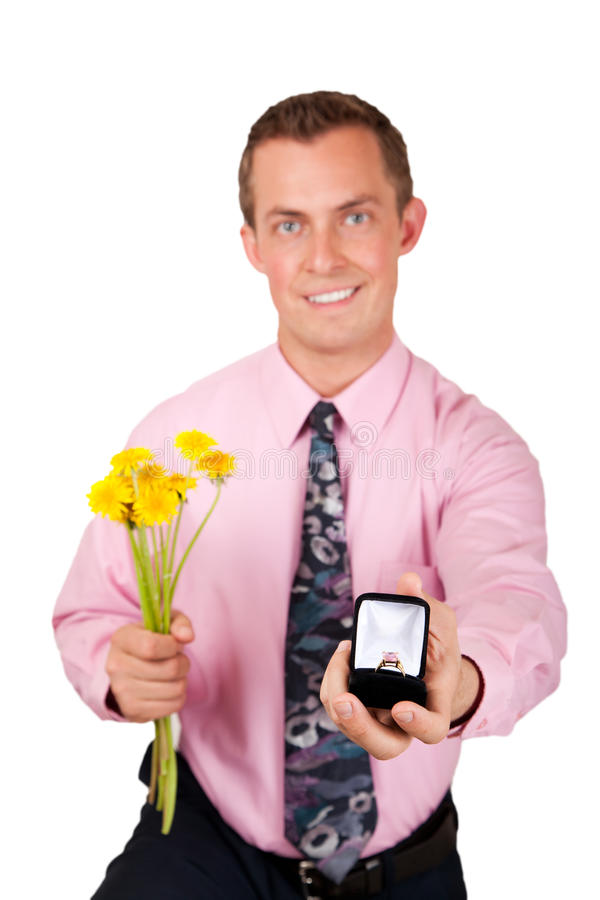 Man in pink proposing. Adult caucasian male on one knee proposing wearing a pink shirt isolated on white background stock images