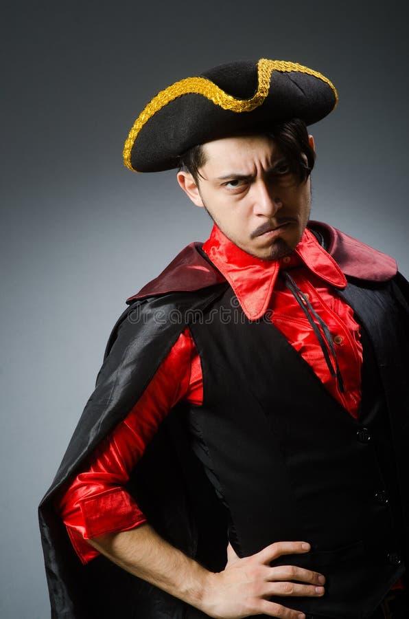 Man pirate against dark background. The man pirate against dark background royalty free stock photo