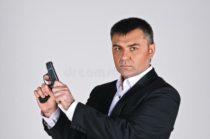 Man And Pistol Royalty Free Stock Images
