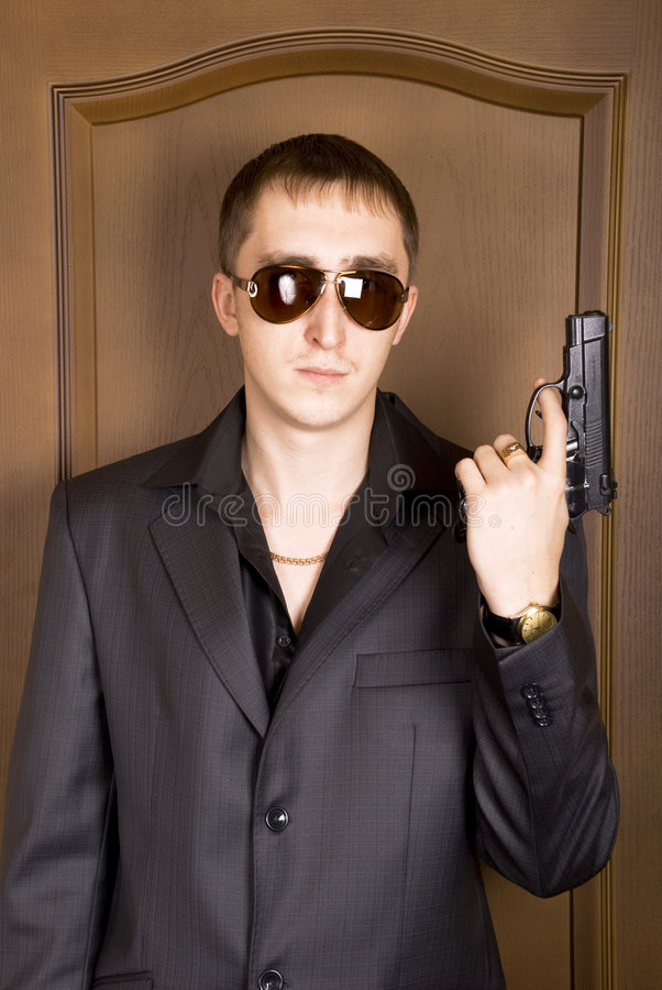 Man with a pistol royalty free stock image