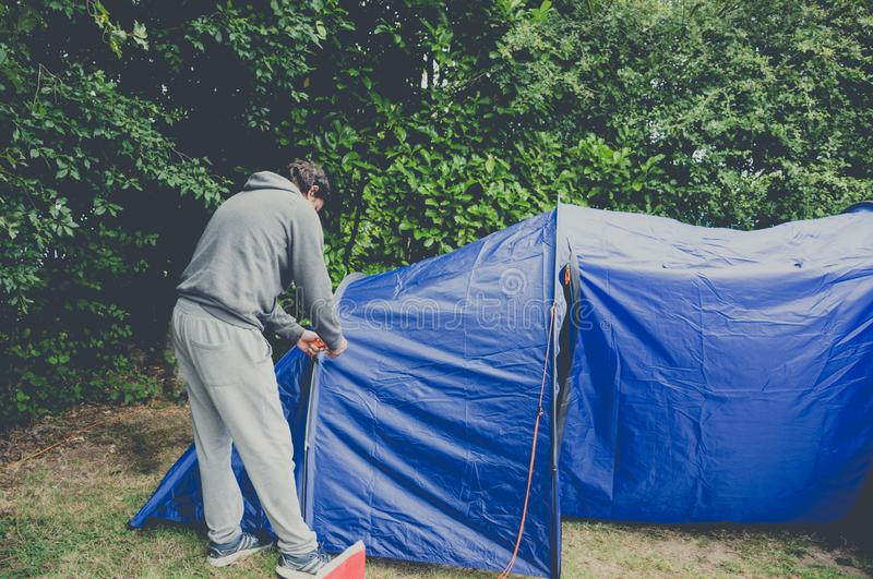 Man pitching tent camping outdoor royalty free stock photo