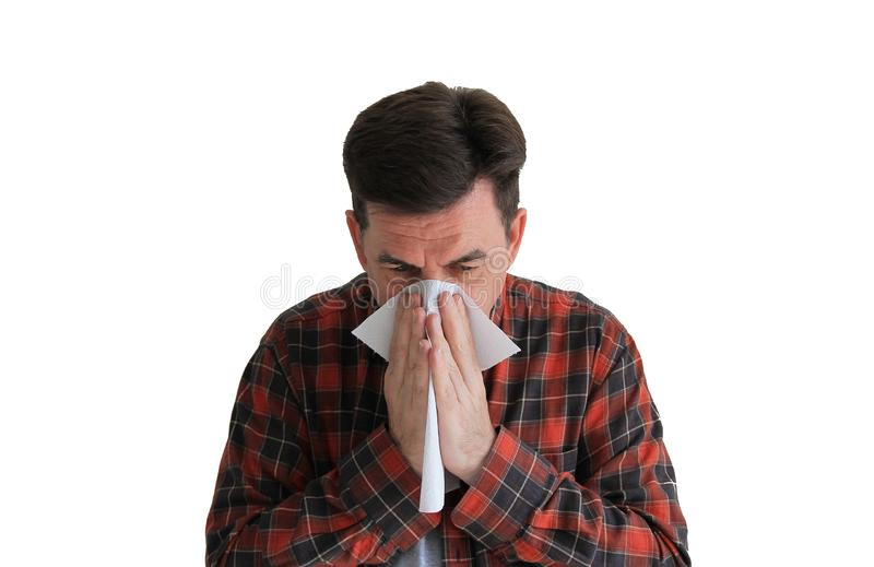 Man in a plaid shirt with handkerchief. Sick man isolated has runny nose, man makes a cure for the common cold. Copy spase stock photos