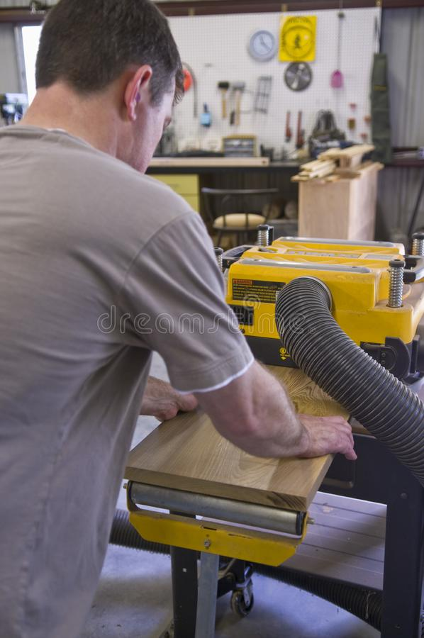 Download Man Planing Board With Machine Planer Stock Image - Image of distichum, planing: 14122069