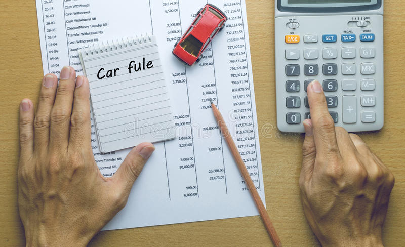 Man Planning Car fule expenses. Finance concept stock image