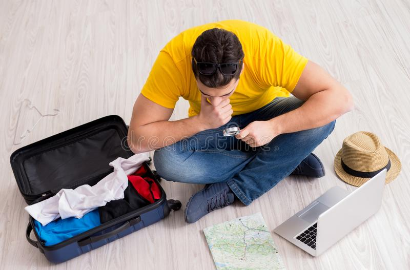 Man planning his vacation trip with map. The man planning his vacation trip with map stock images