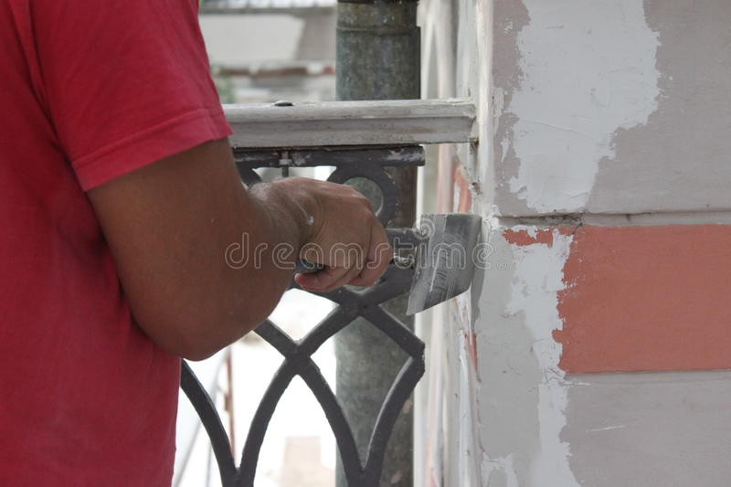 Download Builder working on plaster stock image. Image of home - 32260653