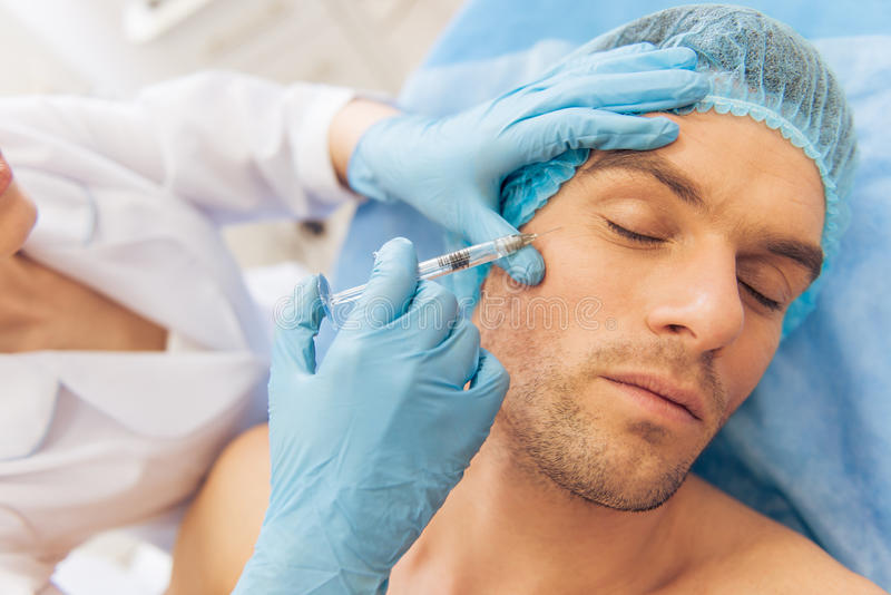 Man at the plastic surgeon stock image