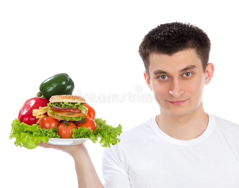 Man with plate of healthy vegetables salad stock image