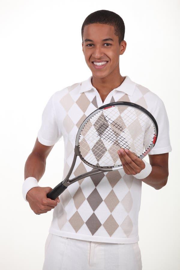 Man plattform med tennisracket arkivfoto