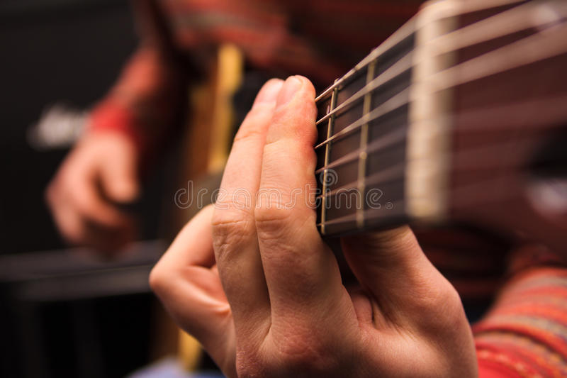Man play on the acoustic guitar stock image