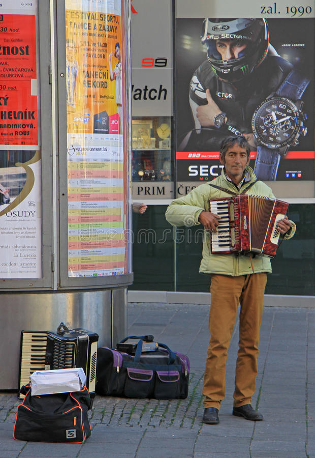 Man is playing accordion outdoor in Brno, Czech royalty free stock images