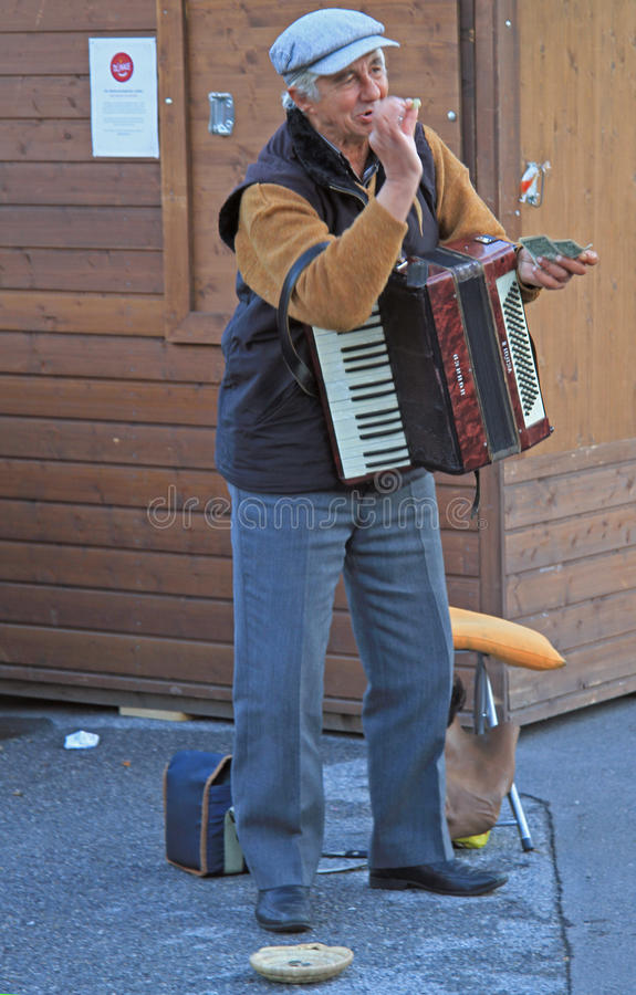 Man is playing the accordion outdoor in Vienna, Austria stock images