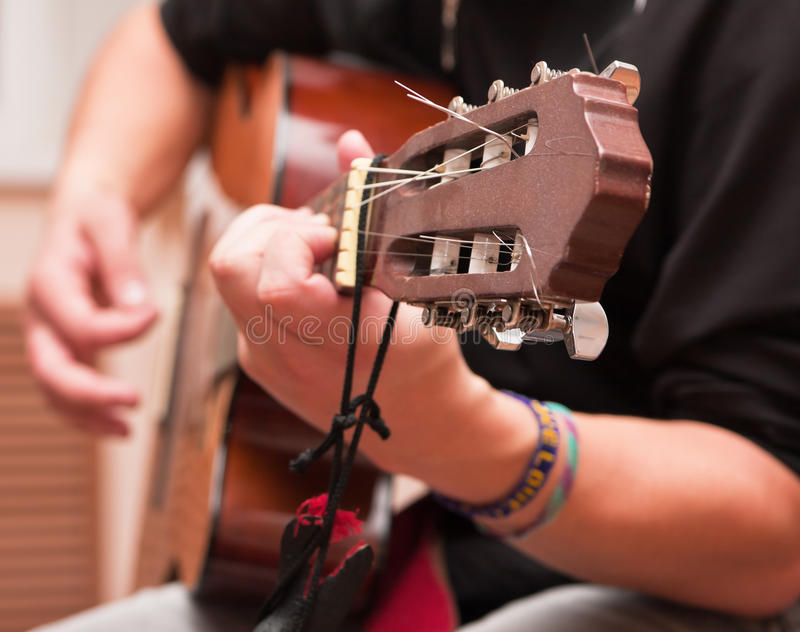 Man playing an accoustic guitar. Man playing a musical instrument accoustic guitar stock images