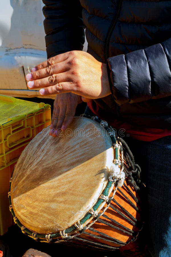 A man playing African Drum Djembe stock image