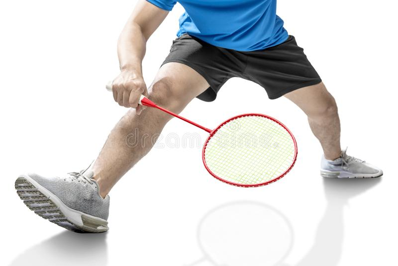 Man playing badminton with badminton racket. Isolated over white background royalty free stock photography