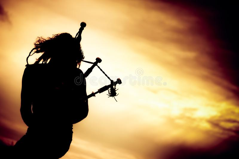 Man Playing The Bagpipe. Silhouette of man playing the bagpipe royalty free stock photos