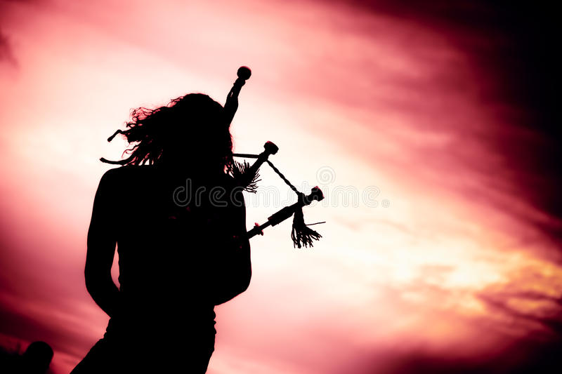 Man Playing The Bagpipe. Silhouette of man playing the bagpipe stock image