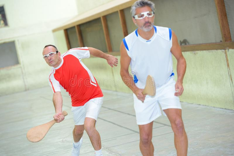 Man playing basque squash royalty free stock photography