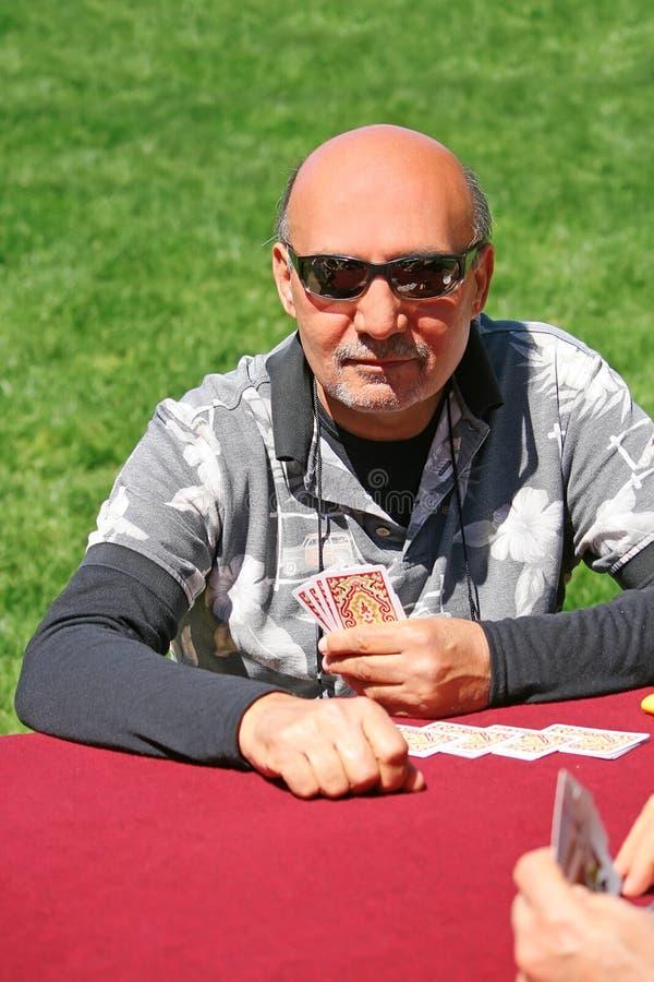 Download Man Playing Cards At Picnic Stock Photos - Image: 19051903