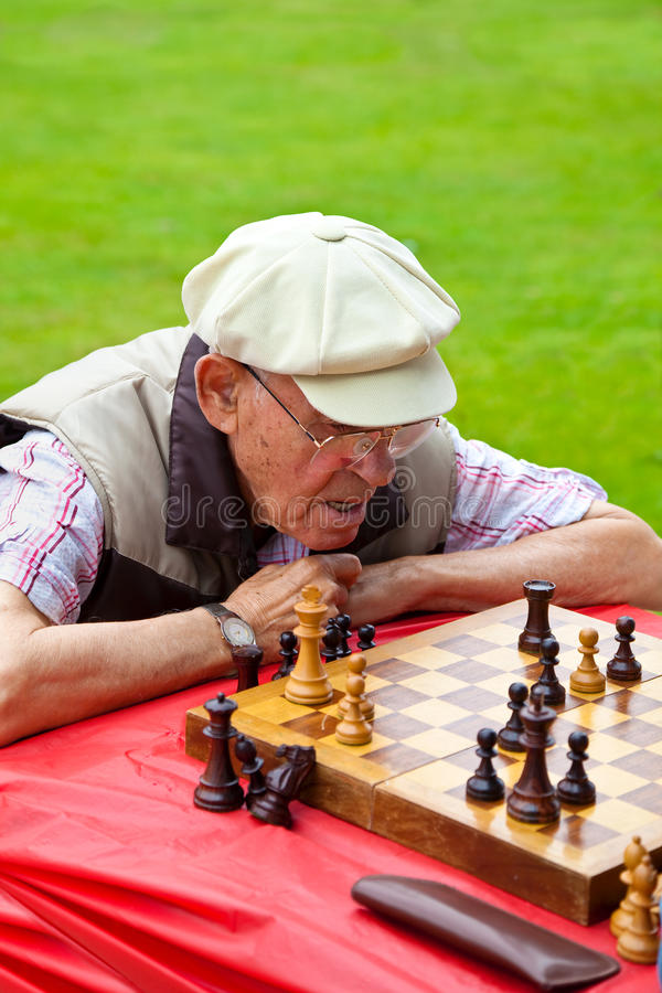 A man playing chess in chess tournament in Santa stock photos