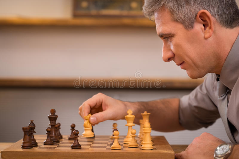 Man playing chess royalty free stock photo