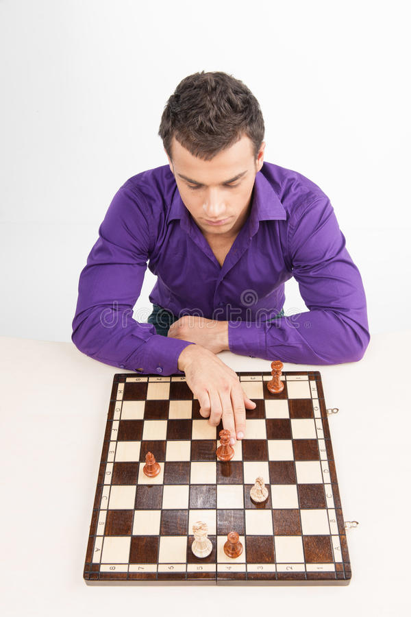 Man playing chess on white background. royalty free stock image