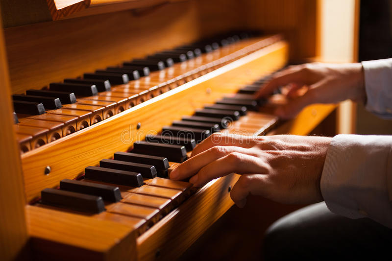 Man playing a church organ royalty free stock image