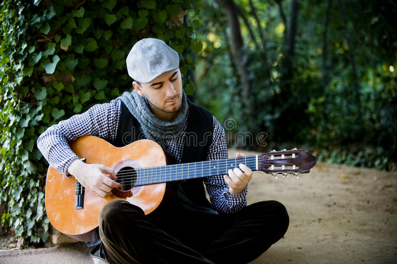 Man playing classic guitar stock photography