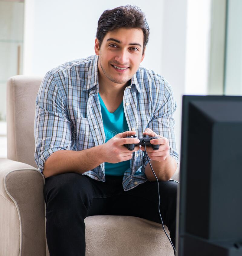 Man playing computer game at home royalty free stock image