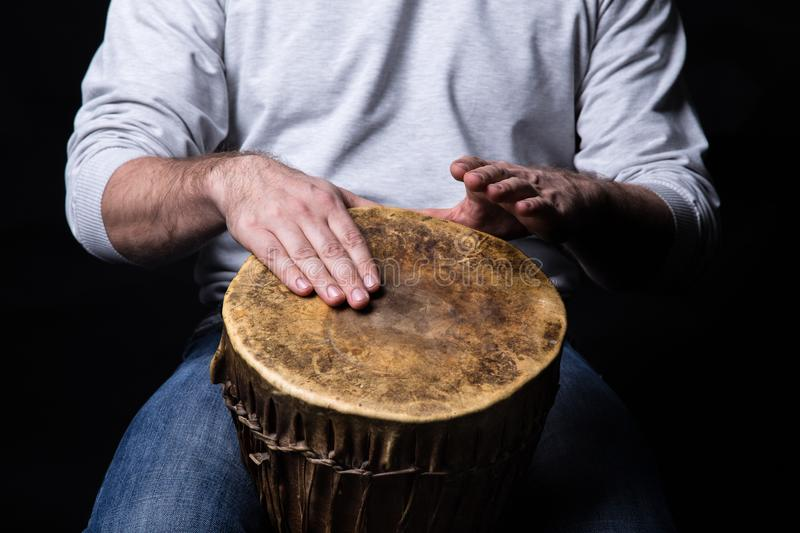 Man playing djembe drum royalty free stock photos