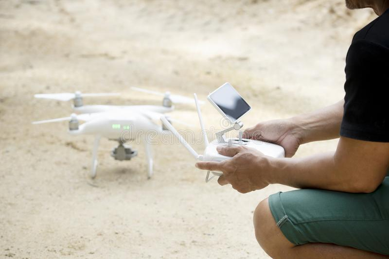 Man playing drone holding remote control in hand royalty free stock images