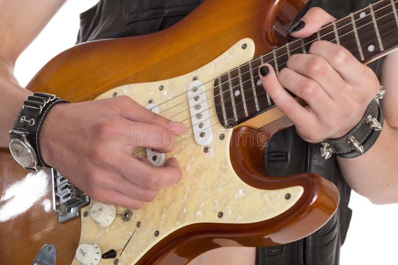 Man playing the electric guitar. stock images