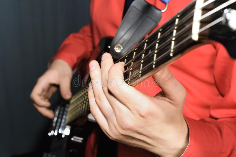 Man playing the electric guitar stock photo