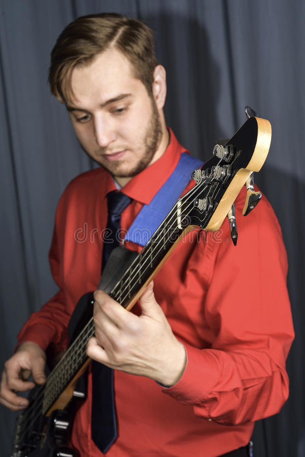 Man playing the electric guitar stock images