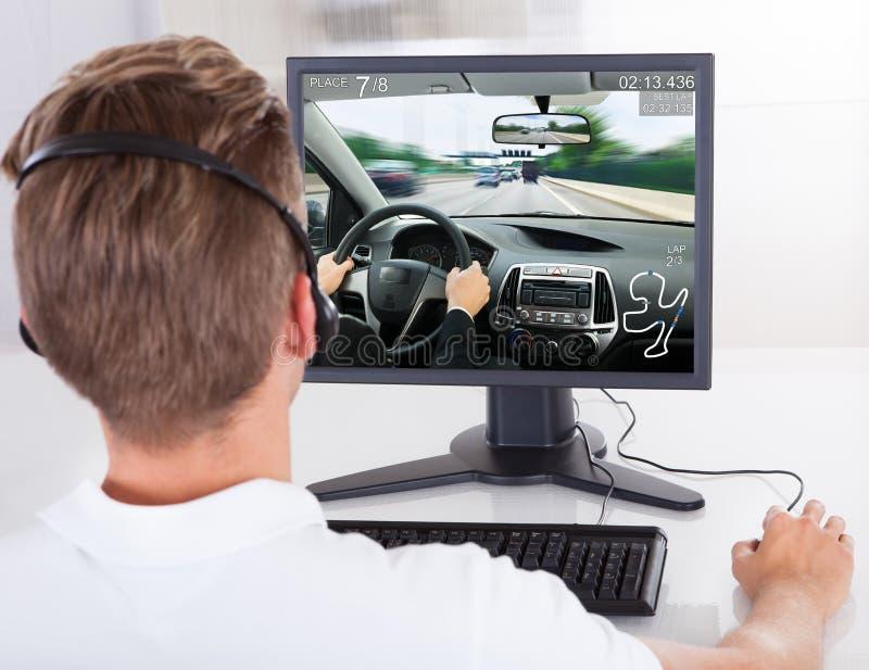 Man Playing Game On Desktop Computer royalty free stock image